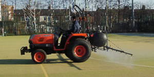 Artificial grass chemical treatment
